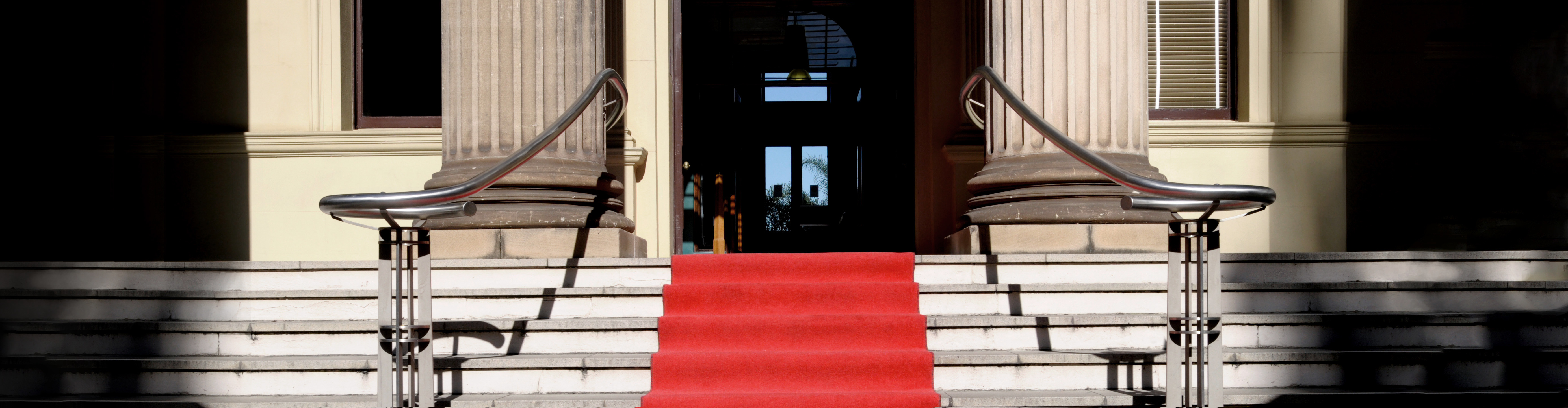 Red carpet laid in front of a Georgian or Regency stone building.  Alternative file shown below: